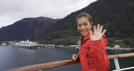 Cruise ship passenger in Alaska city of Ketchikan standing on cruise ship deck ビデオ