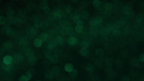 Slowly Rotating Sparkling Green Glitter Bokeh Animation