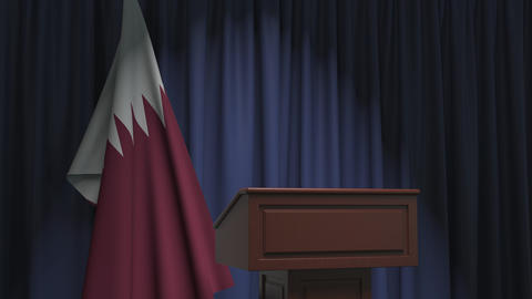 Flag of Qatar and speaker podium tribune. Political event or statement related Live Action