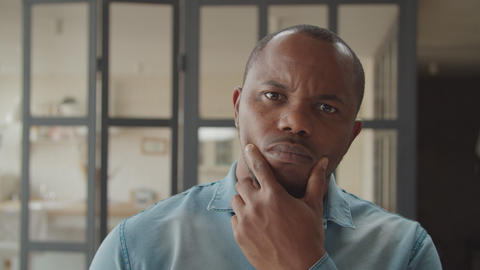 Portrait of pensive african man in deep thoughts GIF
