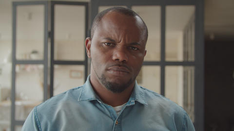 Furious black man looking with intense angry stare GIF