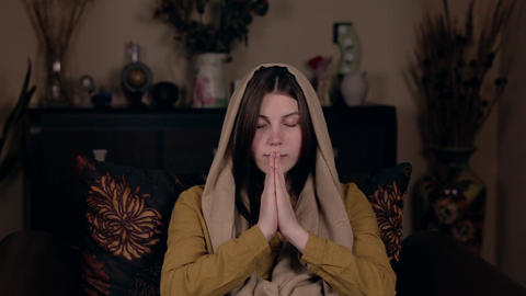 A young pretty Christian woman with a scarf on her head, Caucasian in appearance Footage