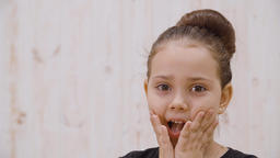 Close-up view of surprised little girl looking at camera GIF