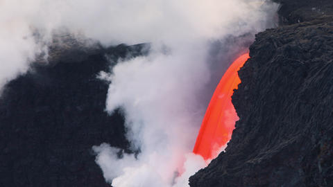 Lava from the Kilauea volcano flows into the ocean GIF