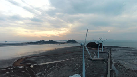 Gray sky sunset Wind power generator Archivo