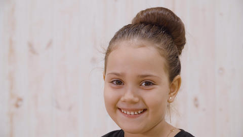 Close-up view of adorable little girl smiling at camera GIF