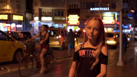 Marmaris, Turkey - September 23, 2019: teenager girl dancing on street on moving ビデオ