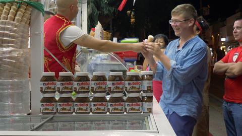 Marmaris, Turkey - September 23, 2019: tourist people buying ice cream in Archivo