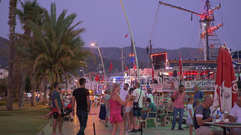 Marmaris, Turkey - September 23, 2019: tourist people photographing on sea quay GIF