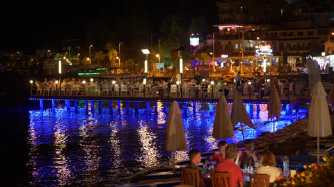 Marmaris, Turkey - September 23, 2019: tourist people resting in evening cafe on Footage