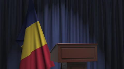 Flag of Romania and speaker podium tribune. Political event or statement related Live Action