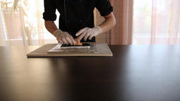 Sushi chef spreads crab meat on a nori leaf.Sushi roll making process.Chef's Archivo