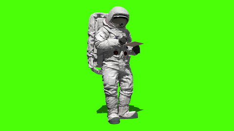Astronaut on the moon typing on a laptop with a green screen ビデオ