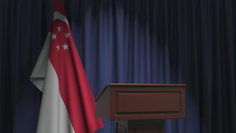 National flag of Singapore and speaker podium tribune. Political event or Live Action
