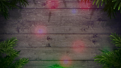 Animated closeup colorful garland and Christmas green tree branches on wood background Animation