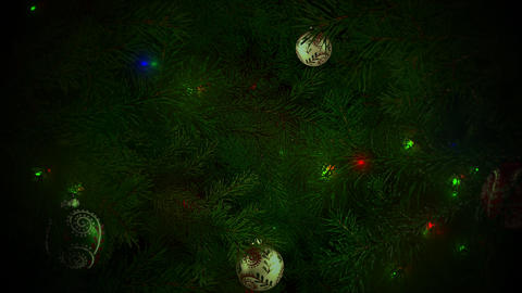 Animated closeup colorful balls and green tree branches on shiny background Animation