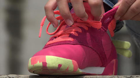 Young Girl Tying Her Sneakers Live Action