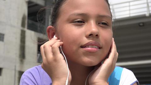 Child Listing to Music on Headphones Footage