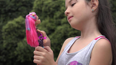 Female Child Playing with Doll Footage