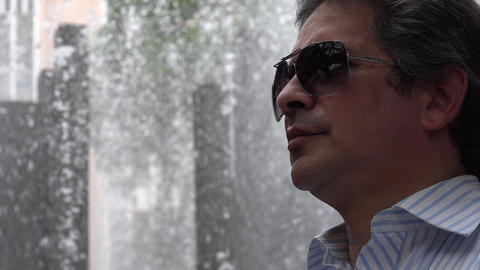Man Wearing Sunglasses at Fountain Footage