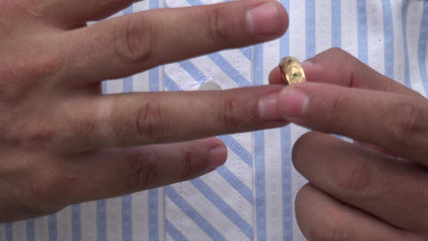 Closeup of Man's Wedding Ring Live Action