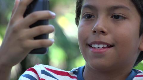 Hispanic Boy Taking Selfie Footage