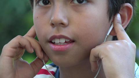 Hispanic Boy Listening to Music Live Action