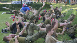 Military taking rest at vierdaags marches,Middelaar,Netherlands Footage