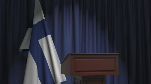 National flag of Finland and speaker podium tribune. Political event or Live Action