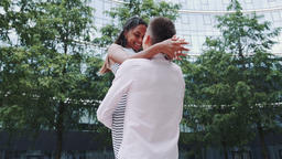 Cheerful boyfriend holding his mixed-race girlfriend in... 動画素材, ムービー映像素材