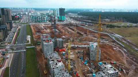 Drone fly around construction crane, development process of high rise block of ビデオ