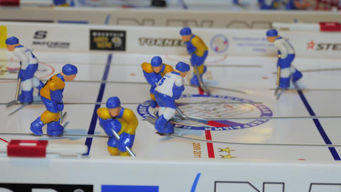 table hockey game with bright figures on arena closeup ビデオ