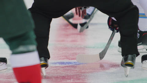 hockey players begin to fight for puck on ice arena at match GIF