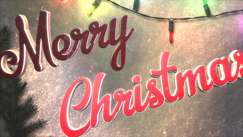 Animated closeup Merry Christmas text, colorful garland and Christmas green tree branches Animation