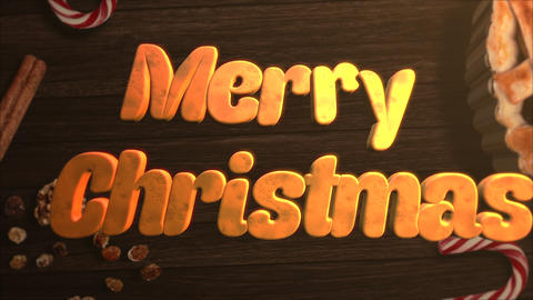 Animated closeup Merry Christmas text, candy and Christmas pie on wood background Animation