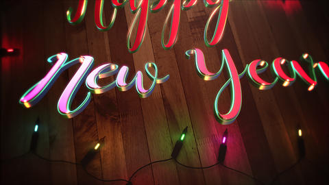 Animated closeup Happy New Year text and colorful garland on wood background Animation
