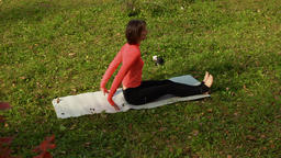 High angle view of sporty woman doing pilates exercise outdoors GIF