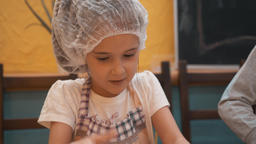 Cute happy girl with rolling pin cooking indoors GIF