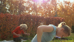 Athletic women in sportswear during fitness workout in autumn park GIF