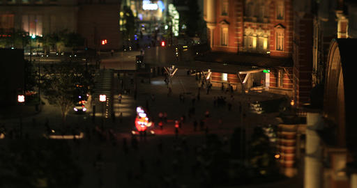 A night cityscape of walking crowd at the business town in Tokyo tilt shift high GIF