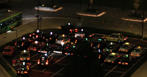 A night cityscape of walking crowd at the business town in Tokyo tilt shift high Footage