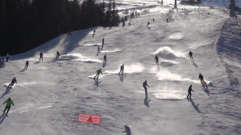 Sunny Winter Slope with Many Skiers. Slow Motion ビデオ