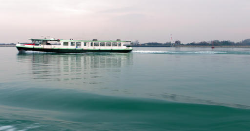Boat motion overlooking the shoreline. Cruise ship wake waves the sea. Venice Live Action