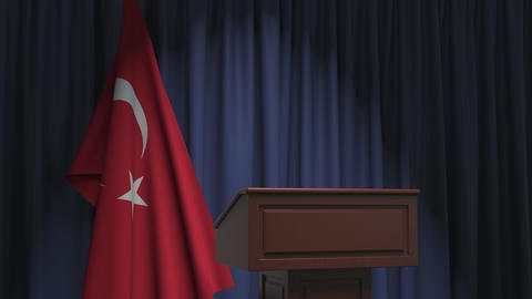 Flag of Turkey and speaker podium tribune. Political event or statement related Live Action