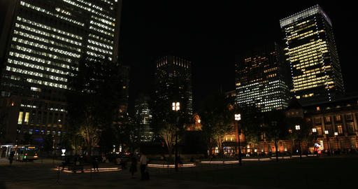 A night cityscape of walking people at the business town in Tokyo wide shot ビデオ