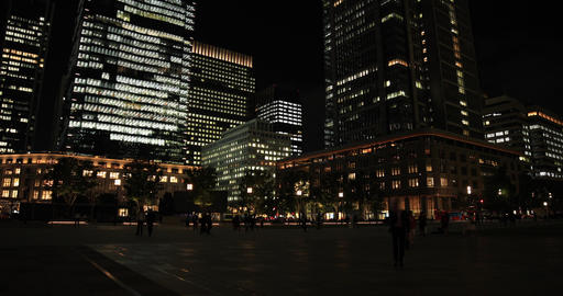 A night cityscape of walking people at the business town in Tokyo wide shot Footage