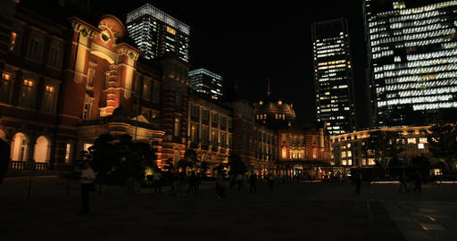 A night cityscape of walking people at the business town in Tokyo wide shot GIF