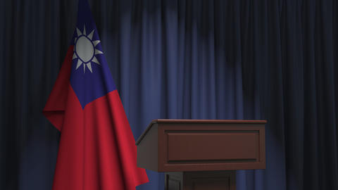 Flag of Taiwan and speaker podium tribune. Political event or statement related Live Action