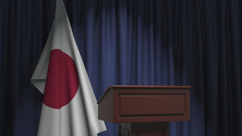Flag of Japan and speaker podium tribune. Political event or statement related Live Action