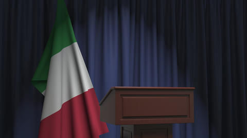 Flag of Italy and speaker podium tribune. Political event or statement related Live Action
